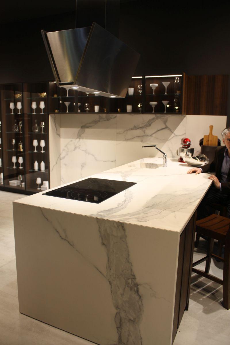 Wood kitchen cupboard and marble backsplash