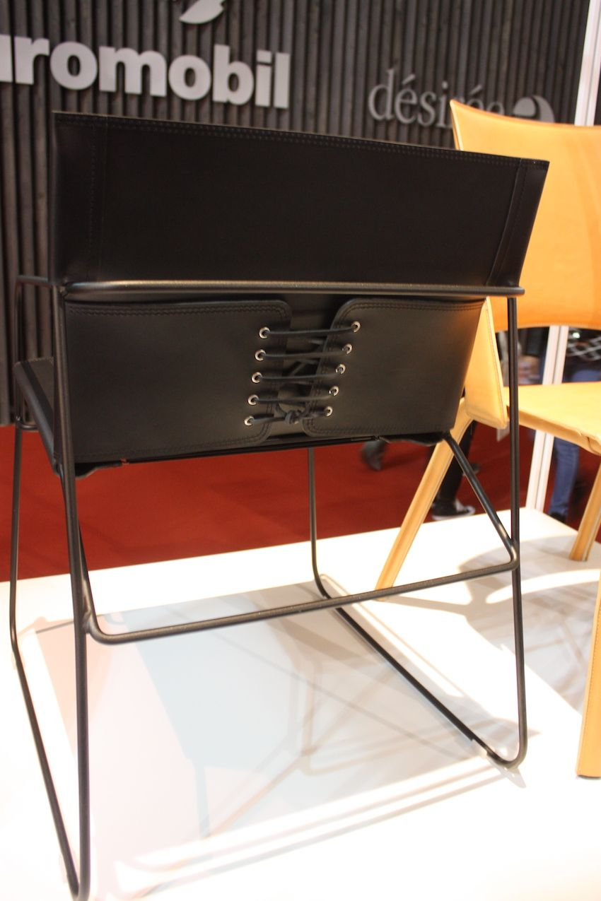 This laced up back is an edgy detail for a leather dining chair. The design is from Airnova, an Italian design company.