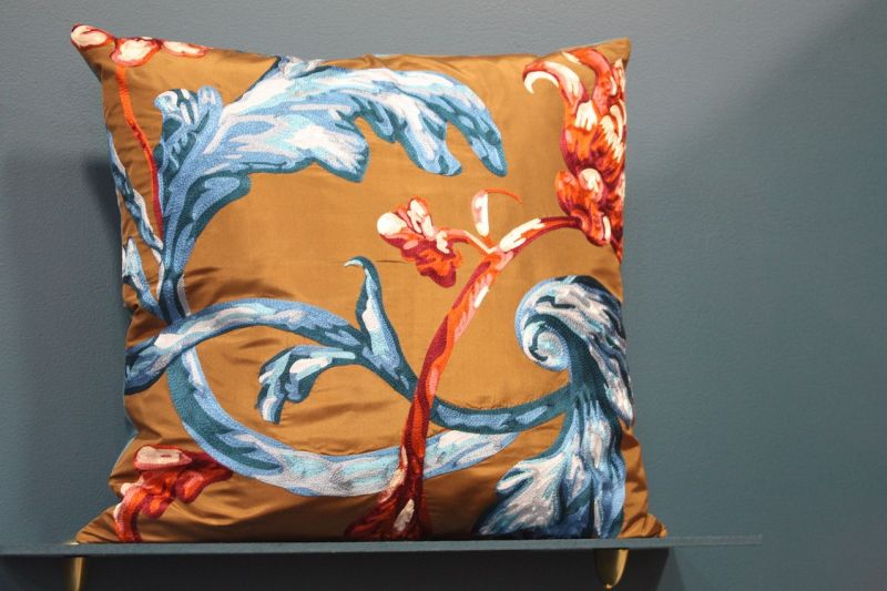 A traditional style motif gets a modern new life on a brightly colored background. We'd love to see this pillow as an accent in a room with modern decor.
