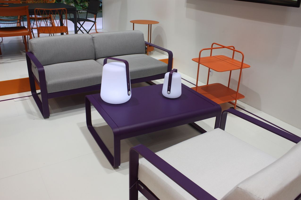 All of Fermob's pieces are colorful. This outdoor furniture set uses a rich purple in combination with a neutral gray tone for the cushions.