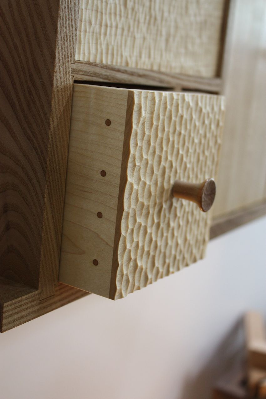Here's a closer look at the hand-textured surface of the wood along with the glue-less joinery Billing uses. Each facet of the cabinetry is a work of art.