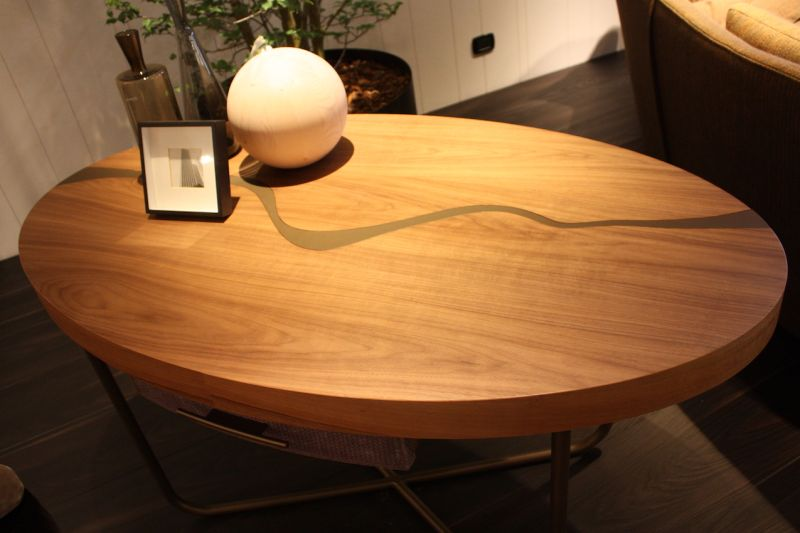 A Thick Wood Coffee Table Top Is Made Light With Modern Metal Base From Il