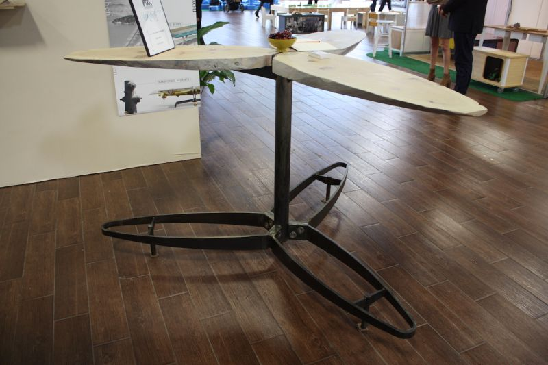"This unusual table from Cravens Partners is made from up cycled pilings. ""Search & Rescue"" is the motto of this company that takes waste materials that were the ""quintessence of their localities"" and turns them into new furnishings that serve people better. This table, with it's winged construction, encourage conversation."