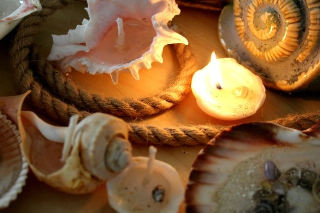 lighted candle in sea shell