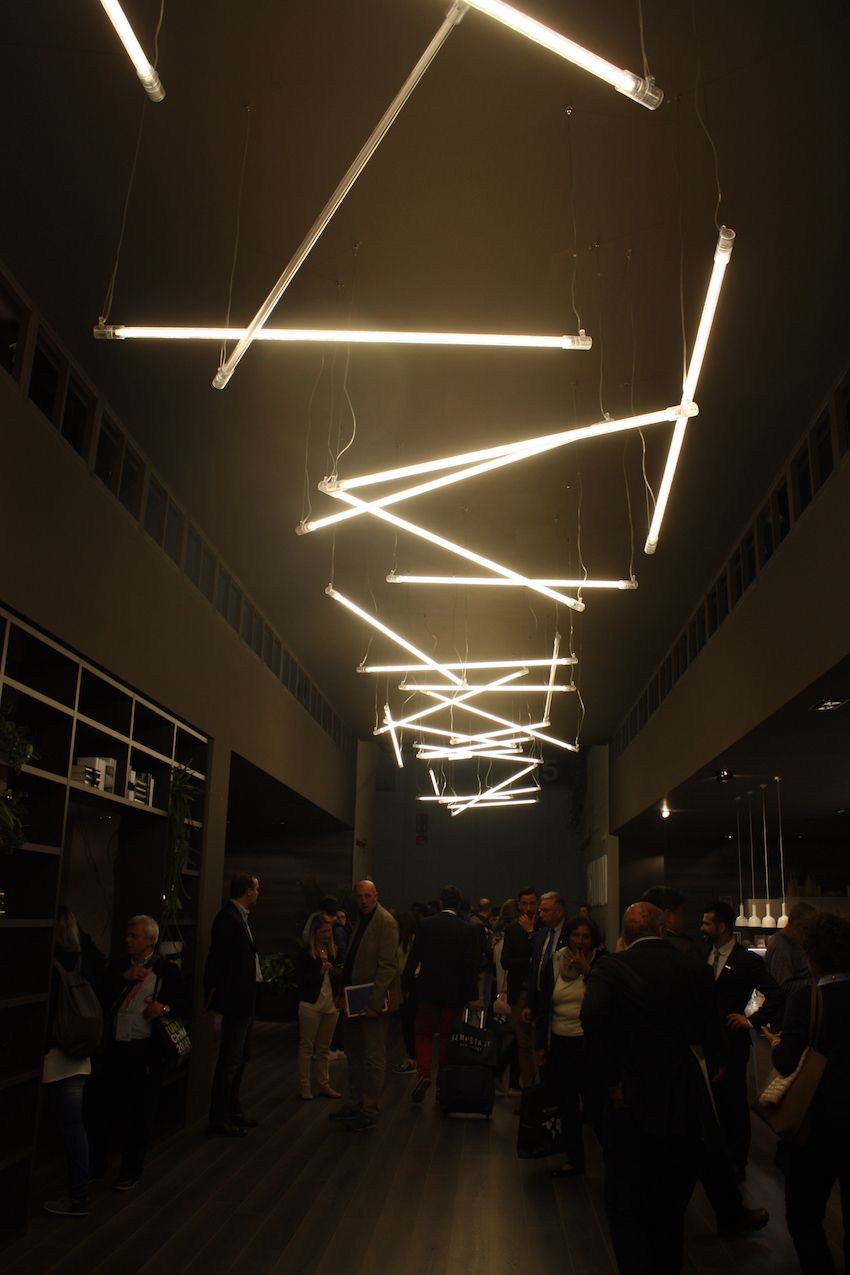 Multiples of one simple stick light make for a dramatic display in the Scavolini booth. & EuroCucina Offers Plenty of Kitchen Lighting Inspiration