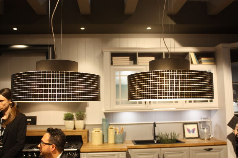 At the other end of the design spectrum are these shiny, modern drum lights, also exhibited by Arrex. Again used in a pair as kitchen island lighting, the pendants also would be appropriate over a dining table.