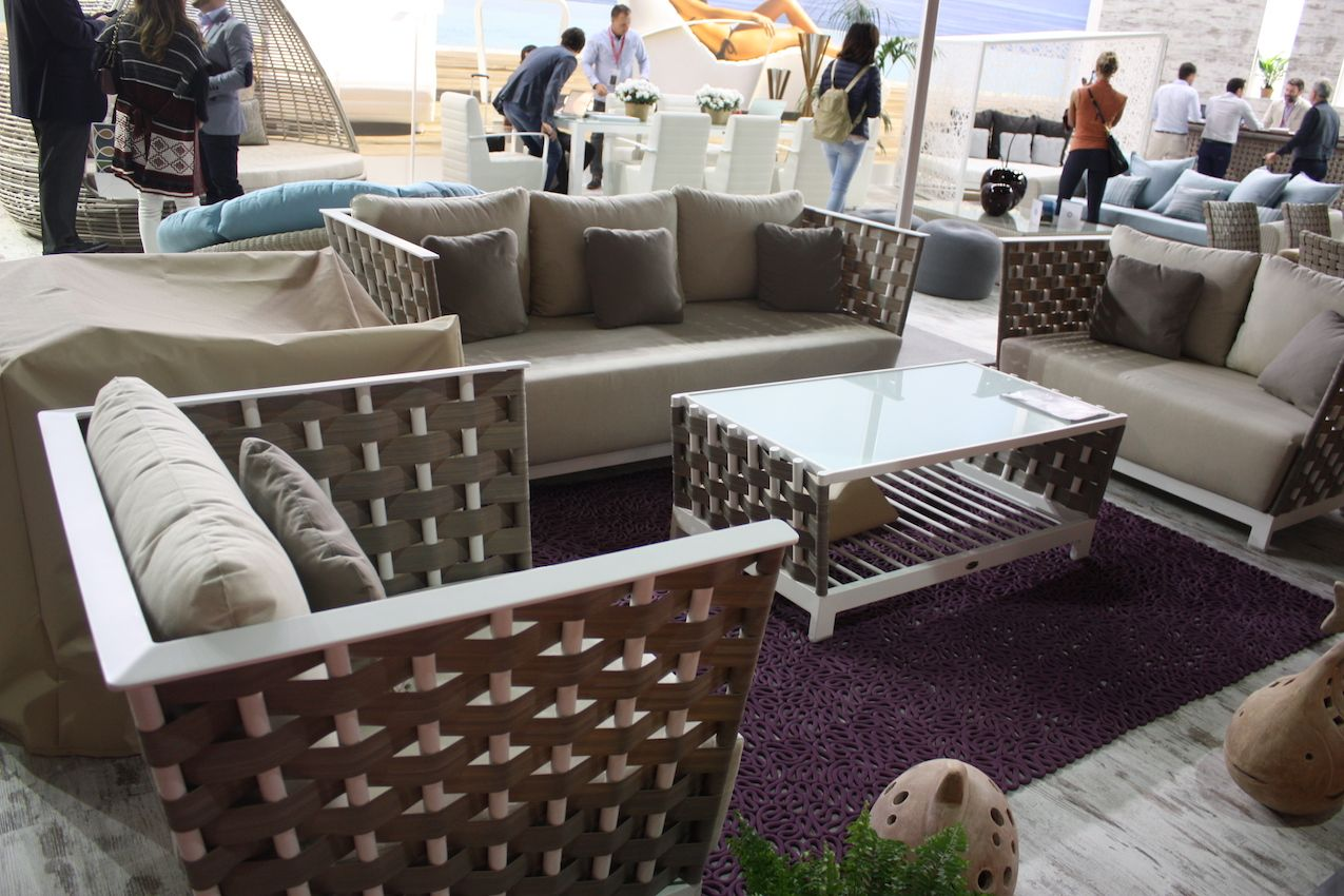 Modern outdoor furniture with a conservative feel -- this grouping by Skyline is called Strips. The pieces are constructed with a white matte aluminum frame and strips of silver walnut Viro fiber. The set has a breezy, tropical style that feels modern, but plush and comfortable.
