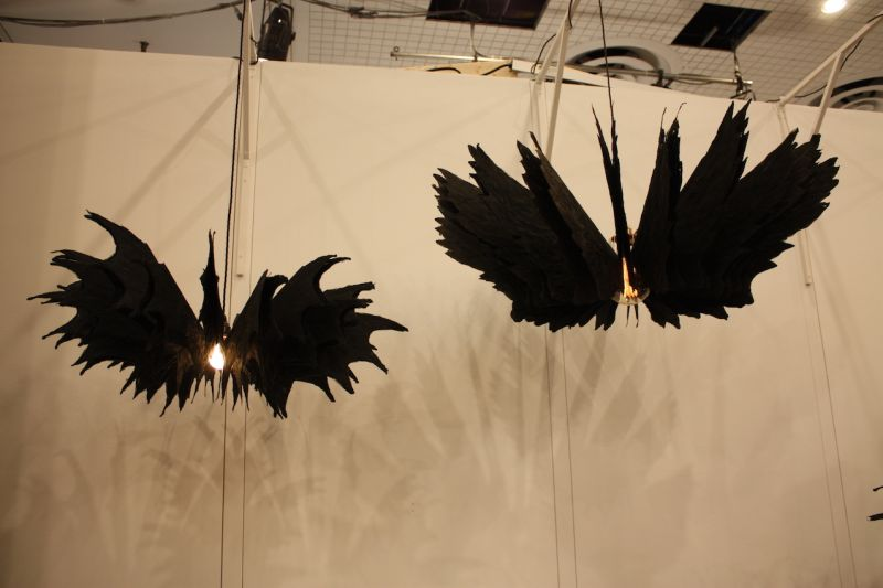 "Dark and gothic, these spectacular lighting fixtures from Daniel Latorre Cruz mesmerize you with their slight motion. the simple act of walking past them set the wings into motion, circling one way, then the other. Called ""the crow,"" they are made of handmade mulberry paper."