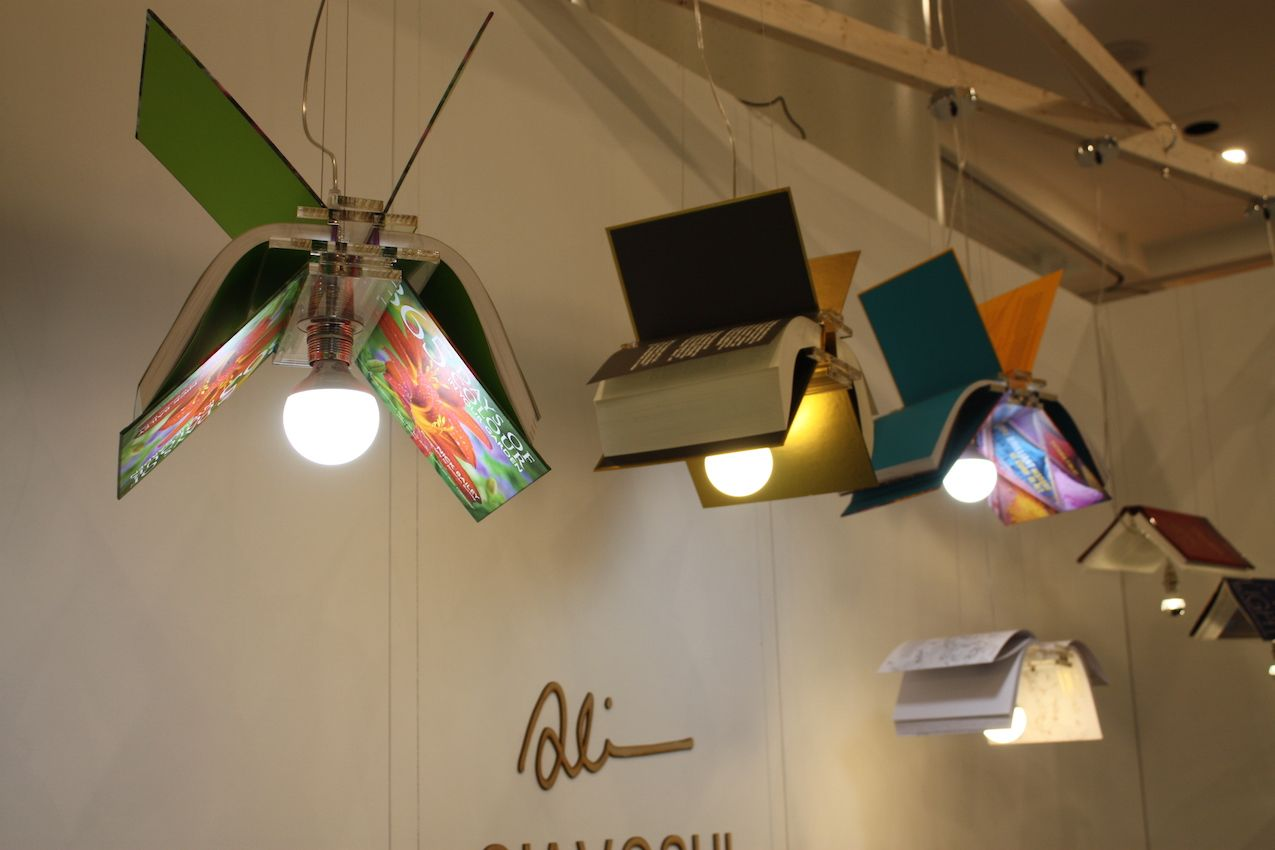 Here, he has reimagined colorful books as lights in flight across the top of your room. The fixtures are based on his design of an acrylic pendant that transforms any book into a lamp! Add your favorite book to the angled pendant turn on the light.