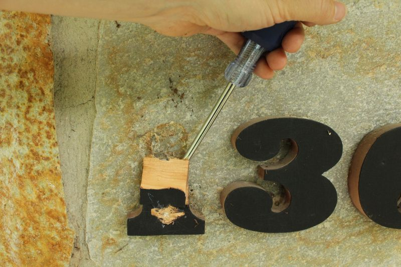 Begin by removing your old house numbers