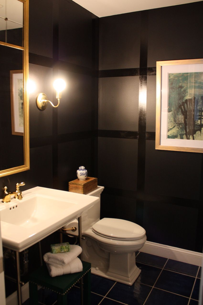 Black in a small bathroom? The answer is a resounding YES! The bold look elevates the small space. We love the wide windowpane design on the walls, and the addition of gold fixtures continues the accent color from the bedroom, adding pop and elegance.