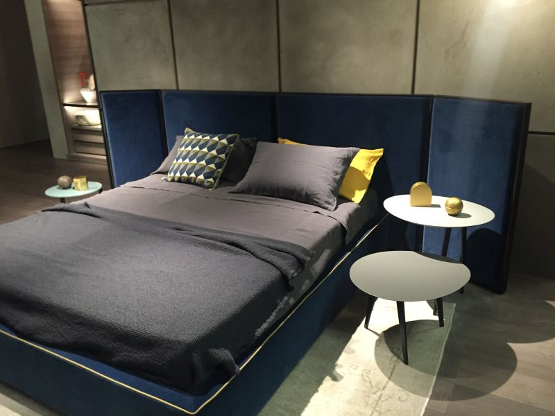 Blue bed and grey wall
