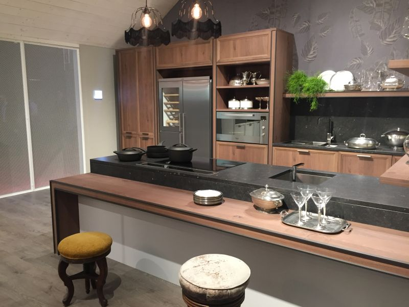 Brown kitchen furniture with black marble