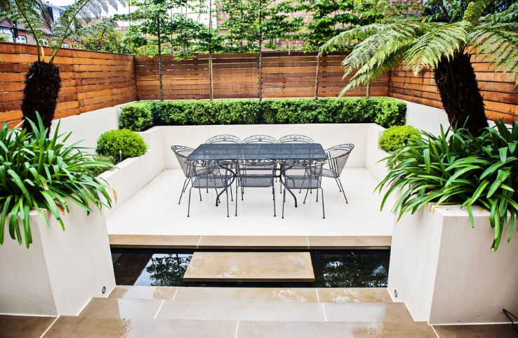 In some cases, concrete planters are designed as a built-in feature for benches and patios
