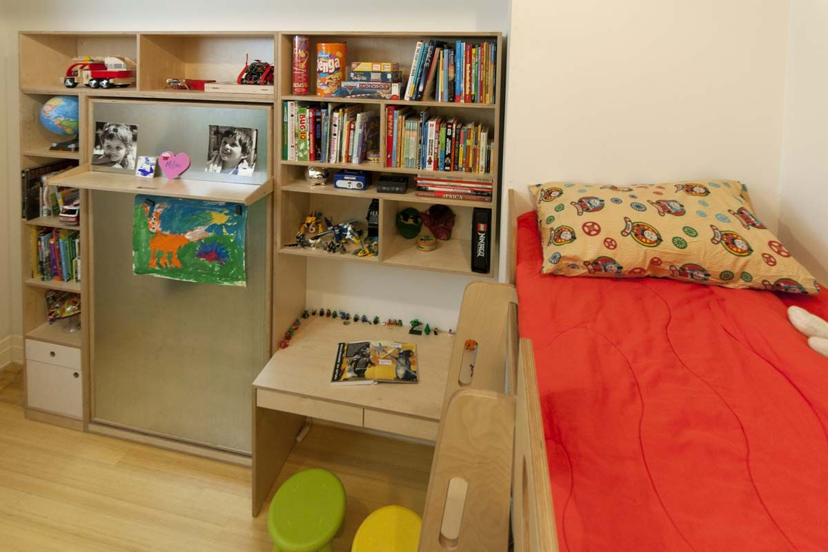 "This room was exceptionally small and Casa Kids created a design that provides sleeping space as well as storage and play space. The custom bed 3"" smaller than a standard twin bed, outfitted with custom mattresses. Even though they are smaller, the beds can still hold the weight of an adult, which allows parents to climb up and down safely.."