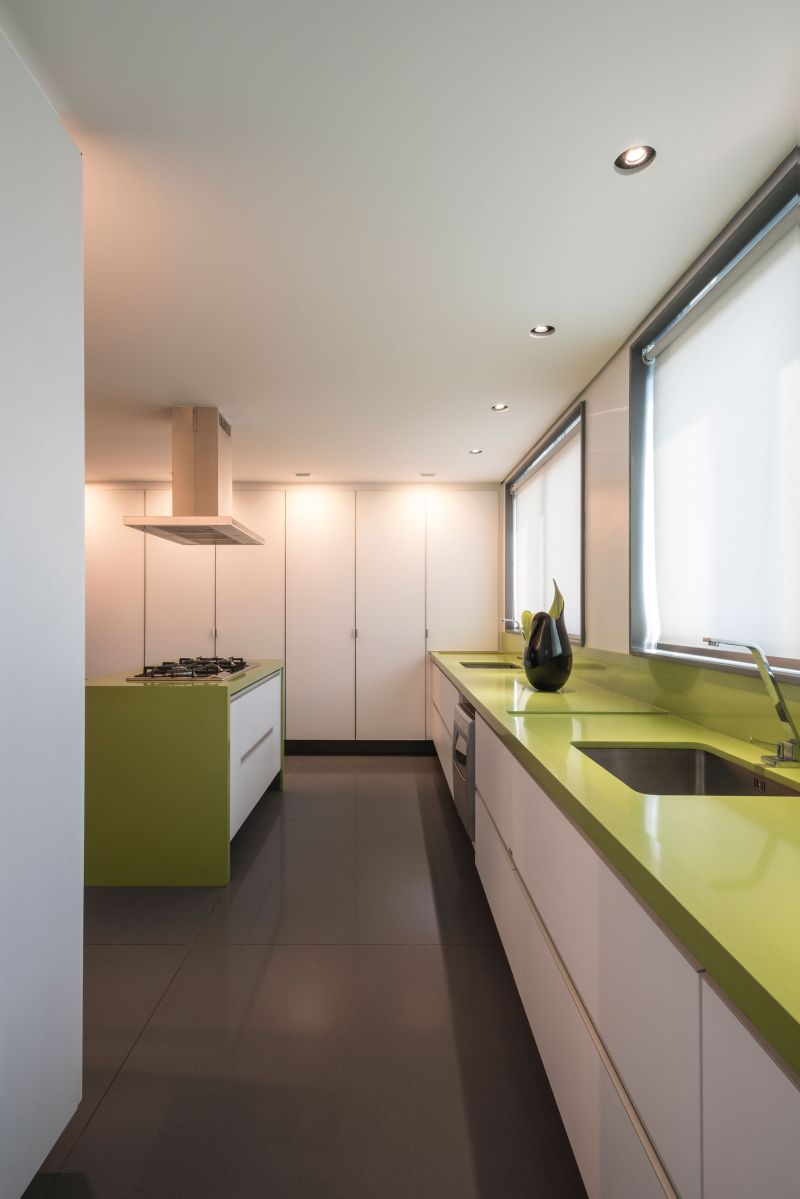Colorful apartment in Brazil green kitchen