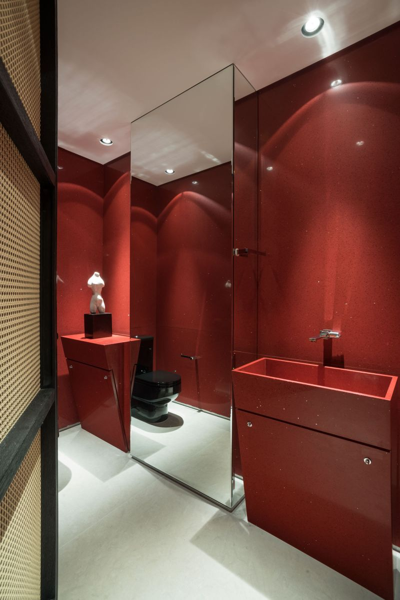 Colorful apartment in Brazil red bathroom