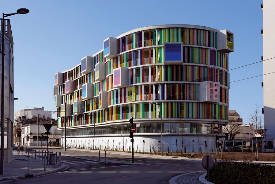 Colorful facade Arc en Ciel building designed by Barnard Buhler Architects