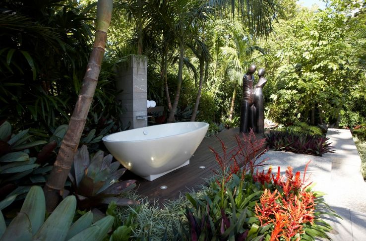 Creating an outdoor spa area with a bathtub and staue