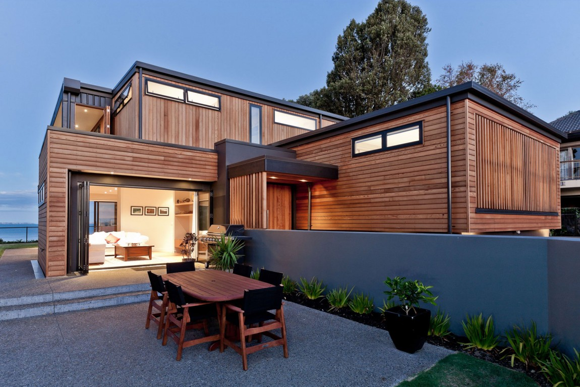 Creative arch design with a wood facade and cool backyard