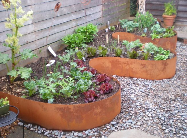 You can have the planters custom-made in specific shapes or design them as flower beds