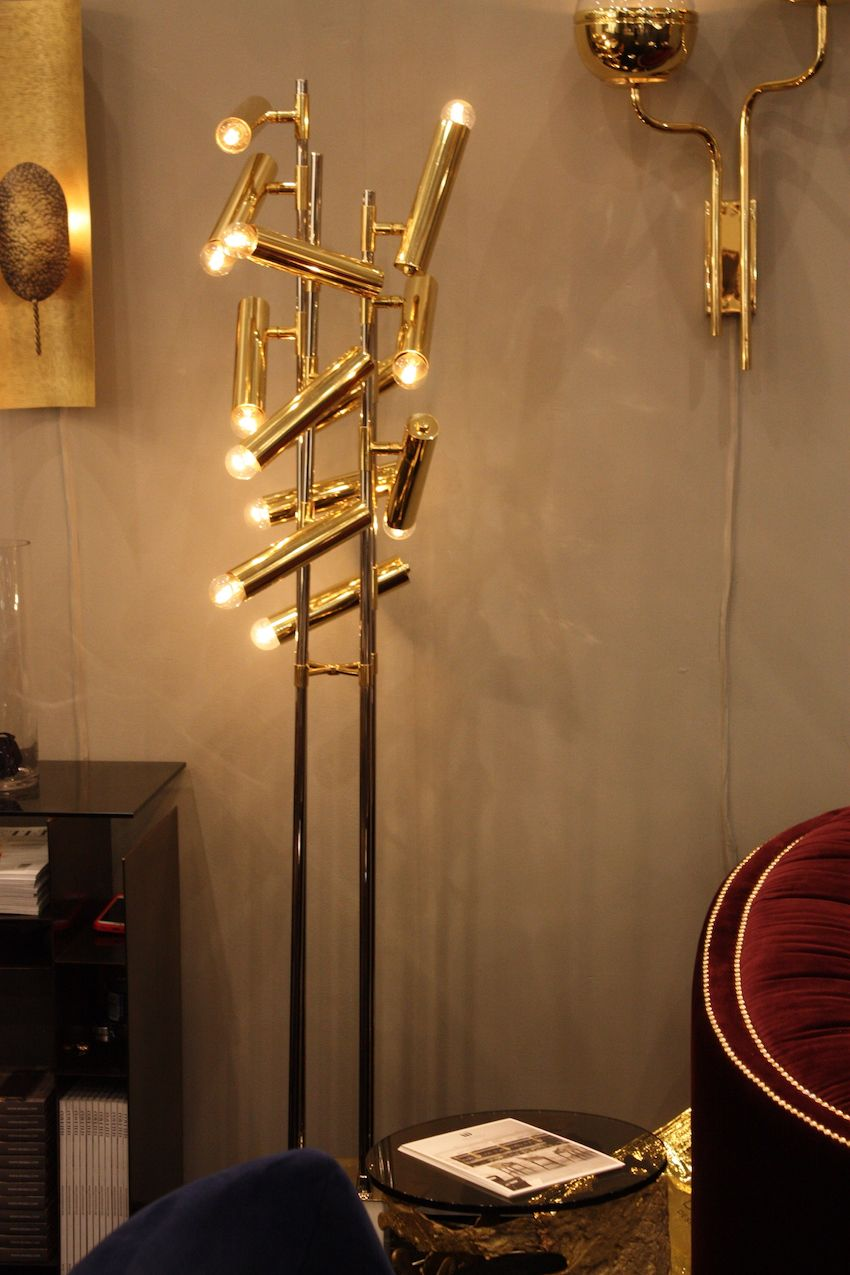 "The Cypres floor lamp is by Brabbu and is meant to evoke the cypress tree, long a source of inspiration in for many artists. Brabbu says that the lamp ""stands strong like the tree with its four gold plated brass sprouts emerging from the Carrara marble base."" The individual lights are like the tree's seed cones. Brabbu is known for its handmade and mid-century modern lighting creations."