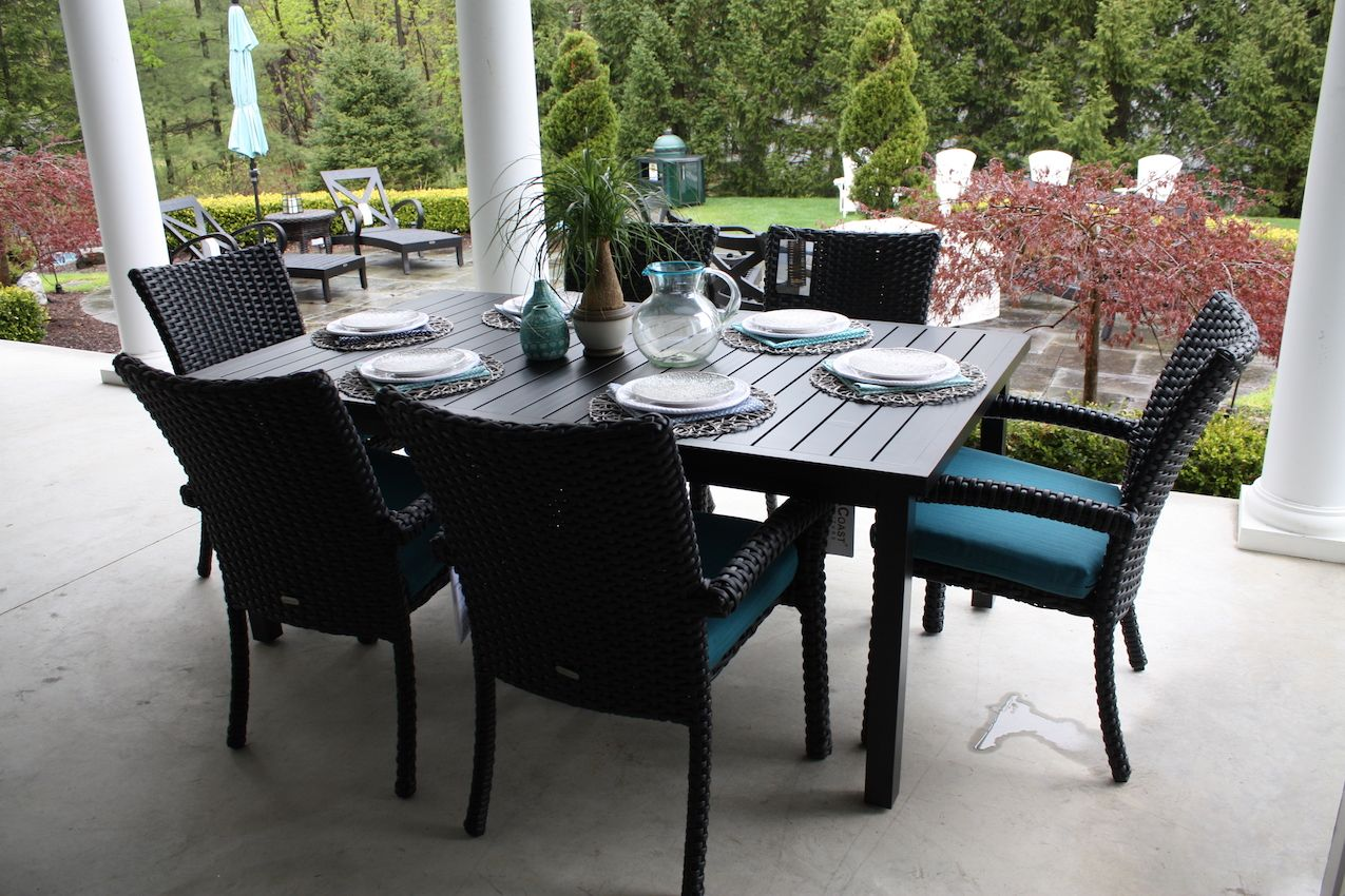 Designer Morgan Stritsman of Best Fire Hearth & Patio really brings the outdoors in with her arrangement of seating and dining areas. The turquoise accents give the space a vacation feel.