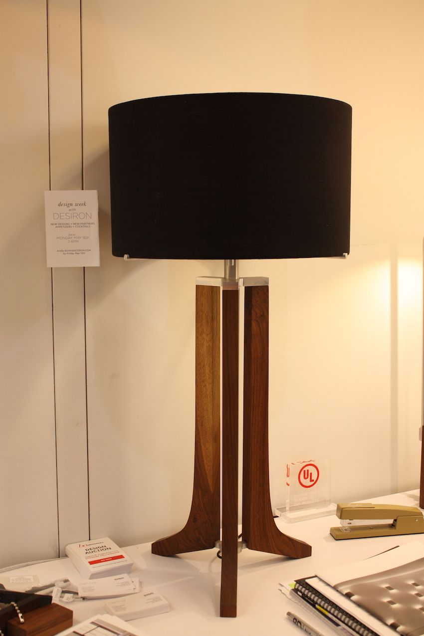 "Cerno, in collaboration with Desiron /Frank Carfaro Hand-Crafted American Furniture, presented the Forma Table Lamp. Designer Nick Sheridan said that he and Carfare designed this more traditional fixture in a way ""that embraced both Cerno and Desiron's aesthetic, without deviating too much from either brand's design language."" The base is made from walnut or dark-stained walnut, topped by a shade in black, white or burlap."