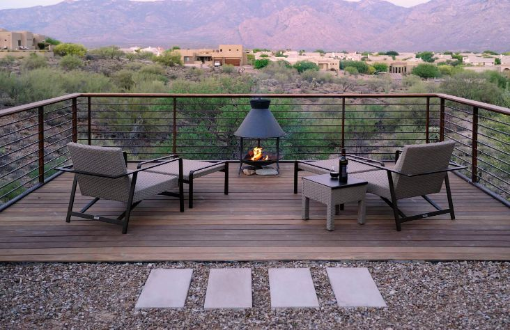 To maximize a beautiful view from the deck, choose glass railing or thin rods