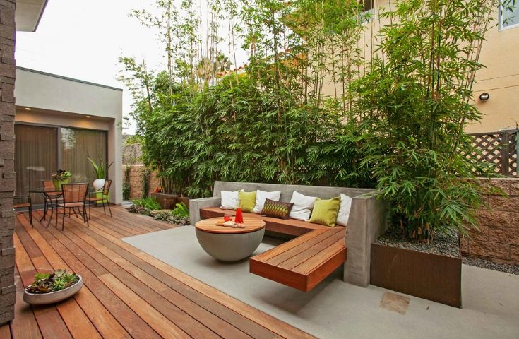 Add color and texture to a deck with beautiful accent pillows and planters.