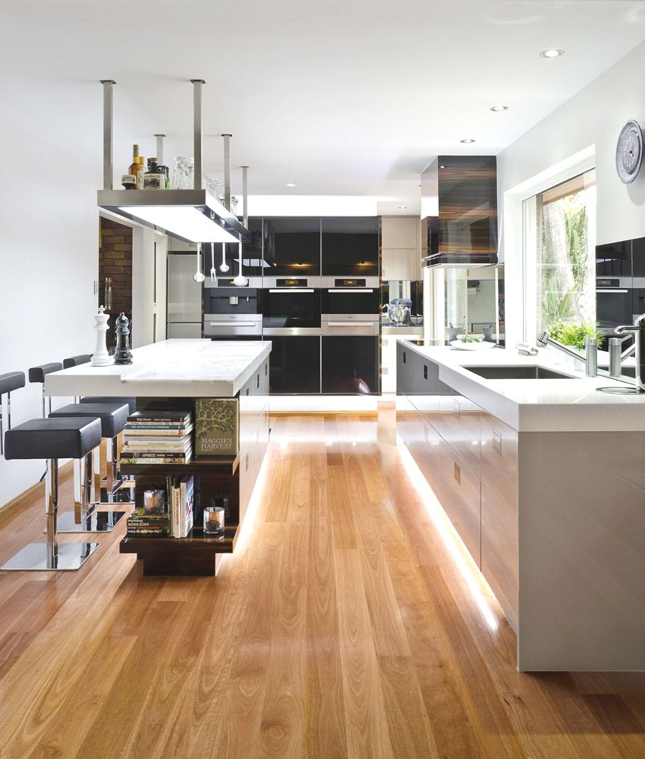 20 gorgeous examples of wood laminate flooring for your for Modern kitchen layout