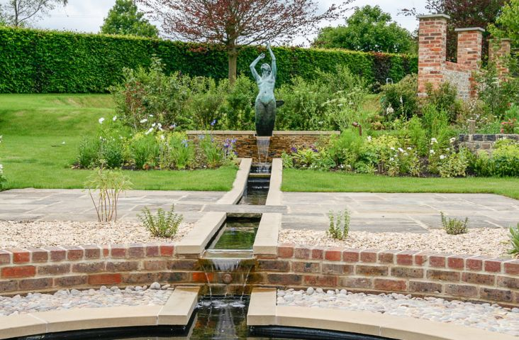 Garden Water Feature Through A Statue