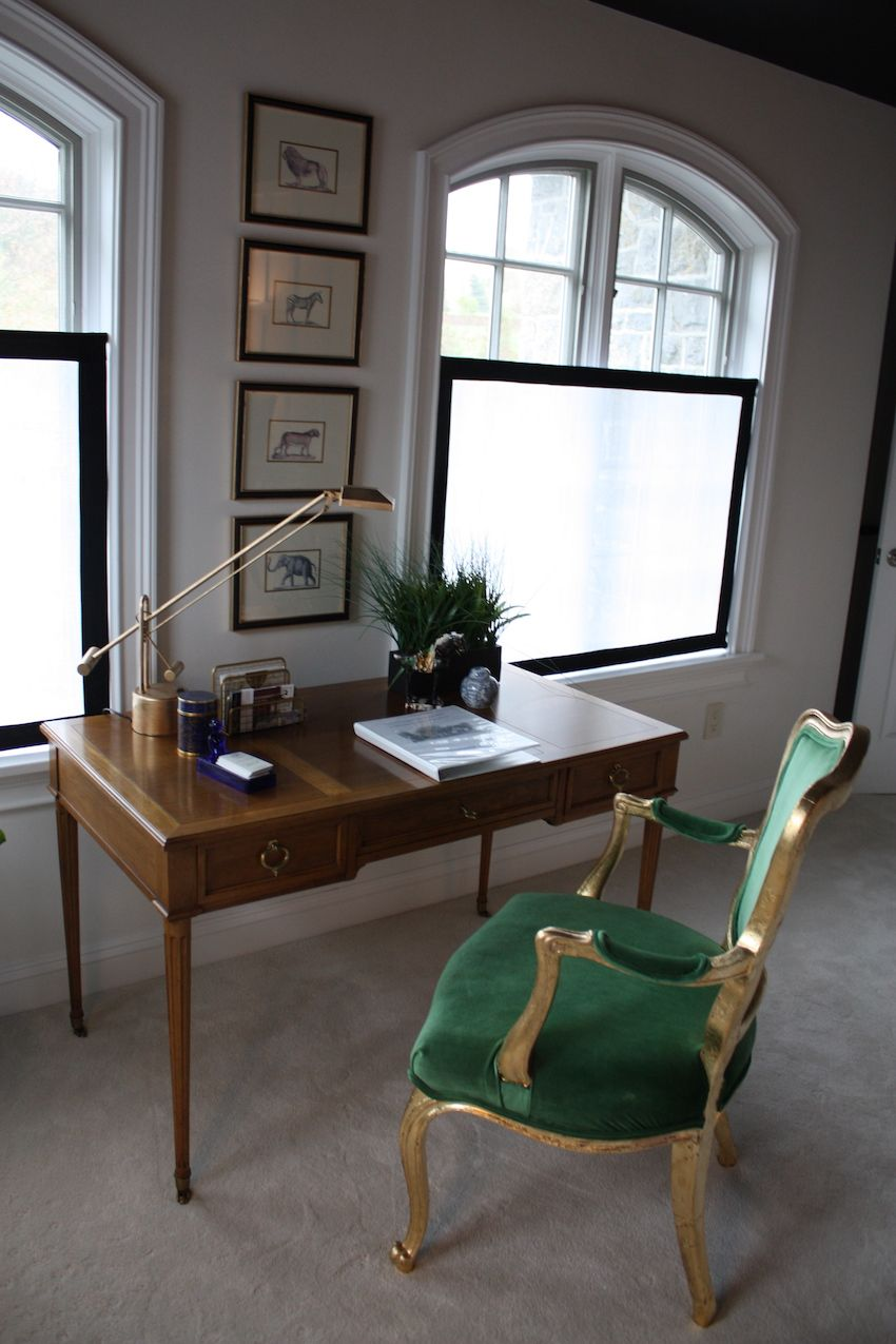The opulent chair green chair at this lovely writing desk does more than provide seating. It gives a regal pop of color in the largely black and white room. The sheer fabric panels help the room maintain their clean lines, provide privacy and still let in plenty of natural light.