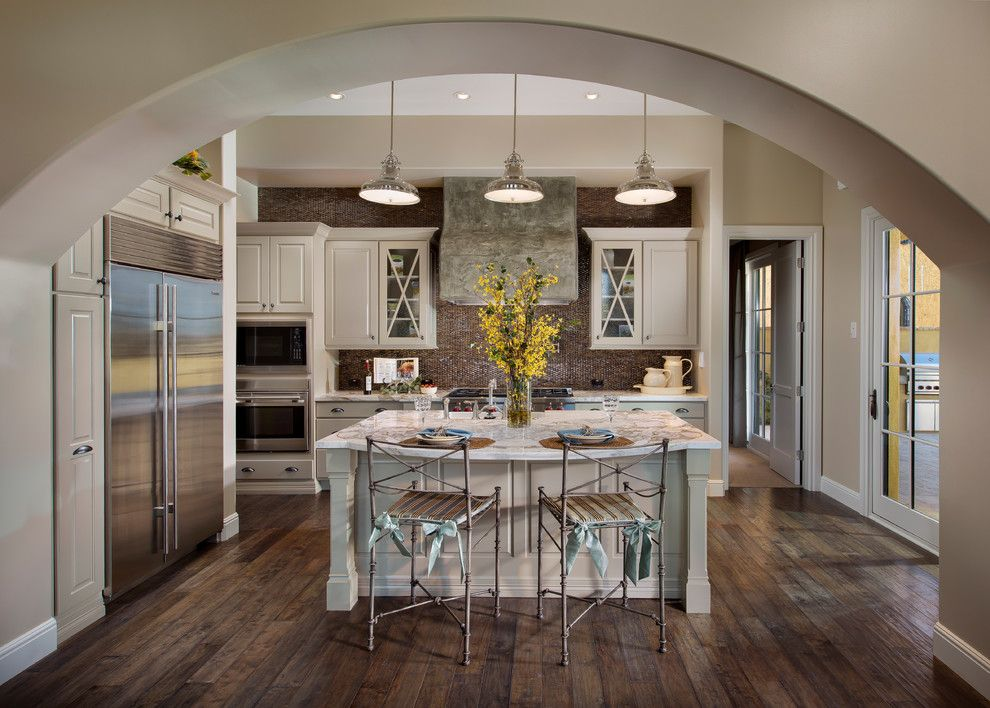 Grand kitchen arch and wood floor