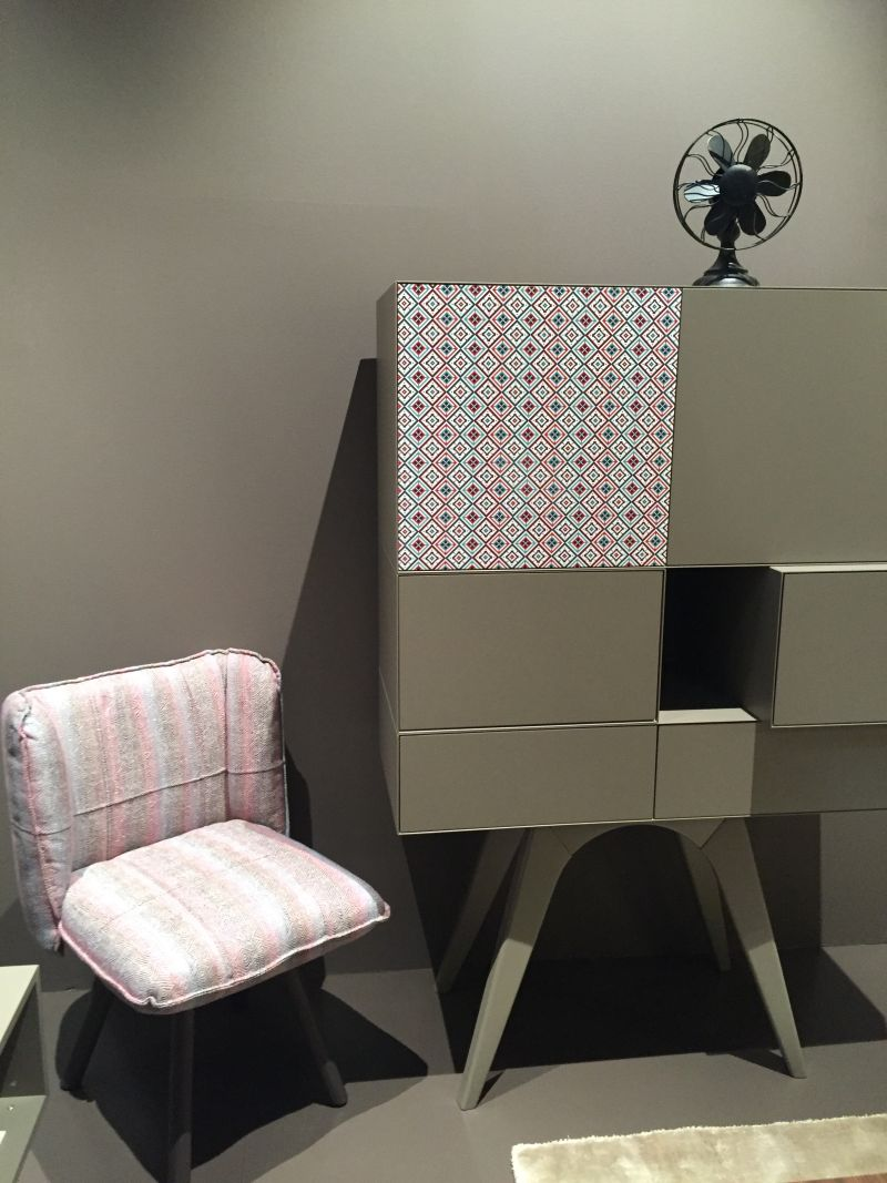 Grey sideboard with a modern pattern on door