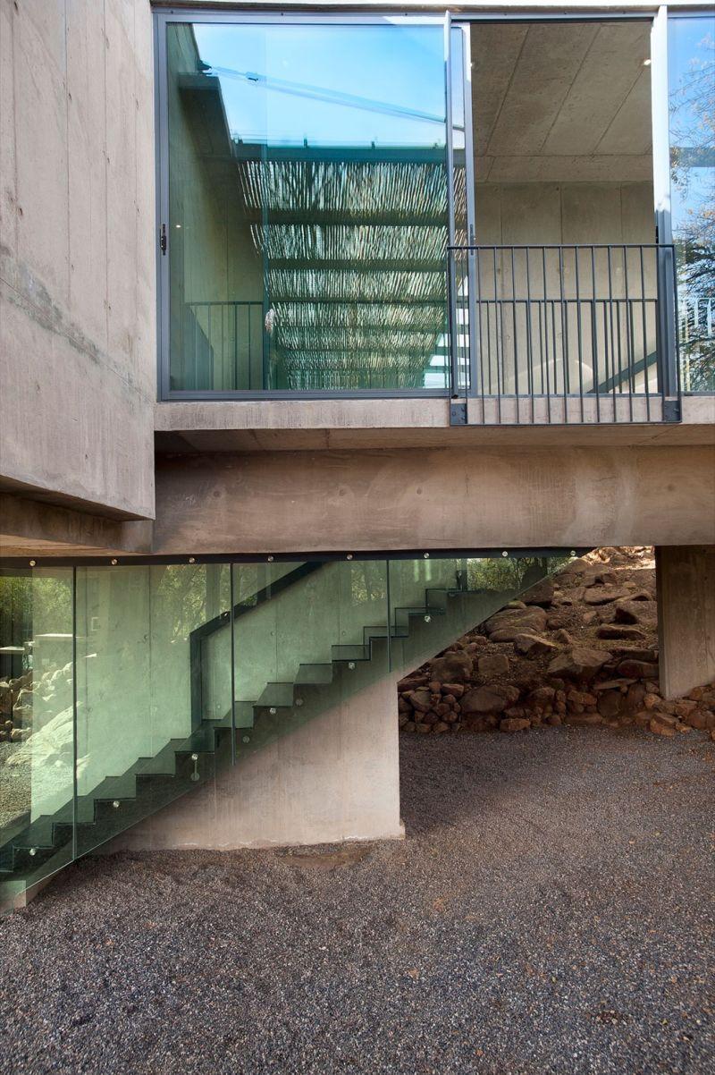House Gauche glass staircase wall