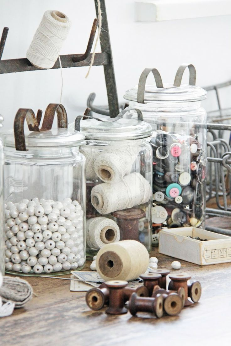 Keep craft supplies in apothecary jars