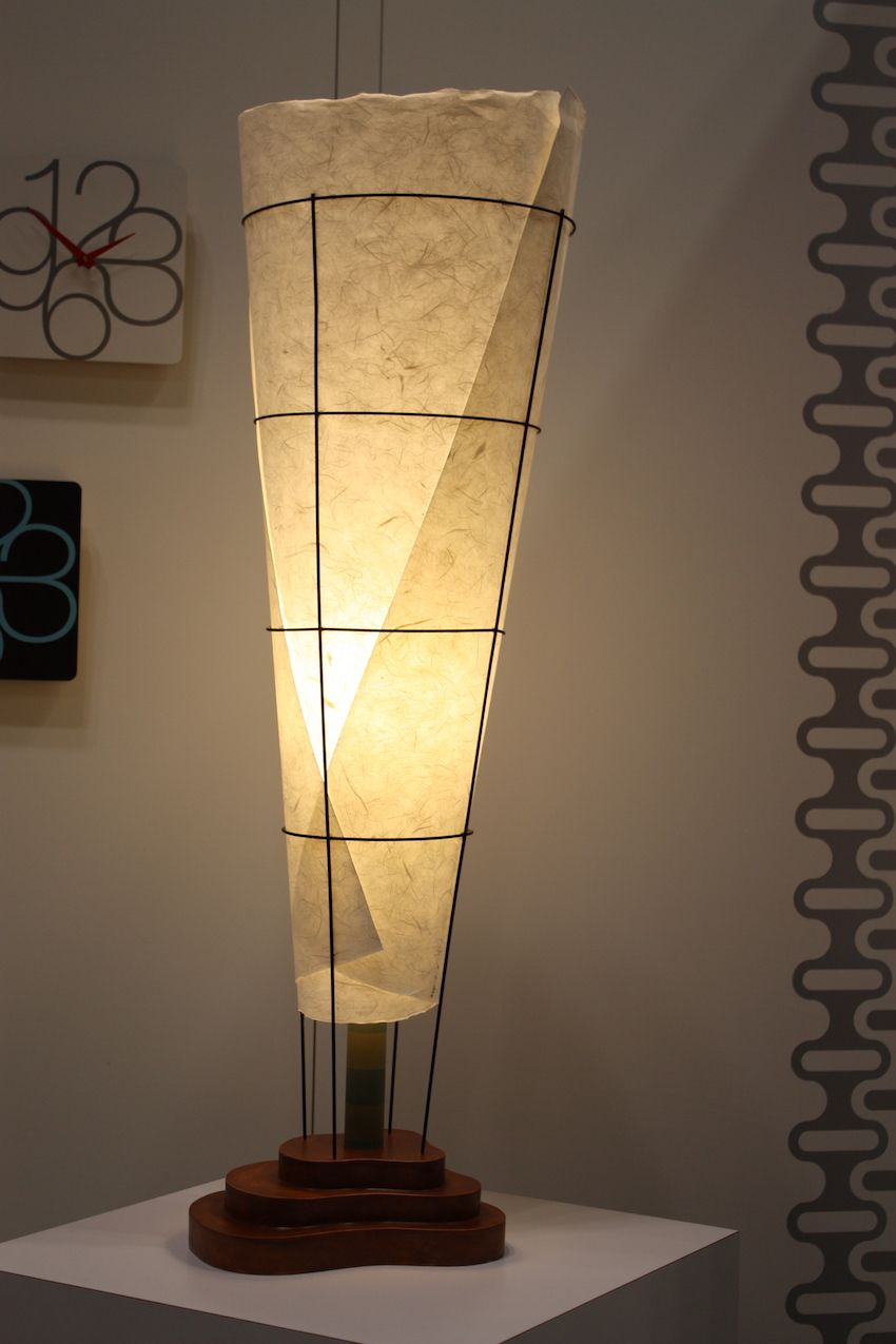 "Moore uses wood, metal, ceramic, and plastic, and artisan paper to create lighting ""that balances modern sensibilities with warmth."""