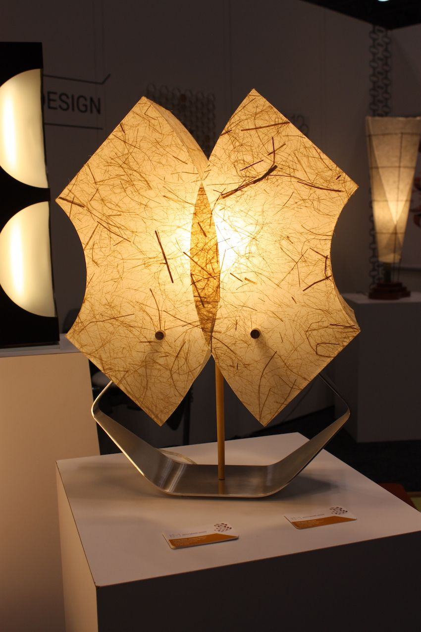 The handmade nature of Keith Moore's designs shine through no matter whether he is producing furniture, lighting or accessories. We love the table lamp he crafted using a fibrous, hand-made paper for the shade.