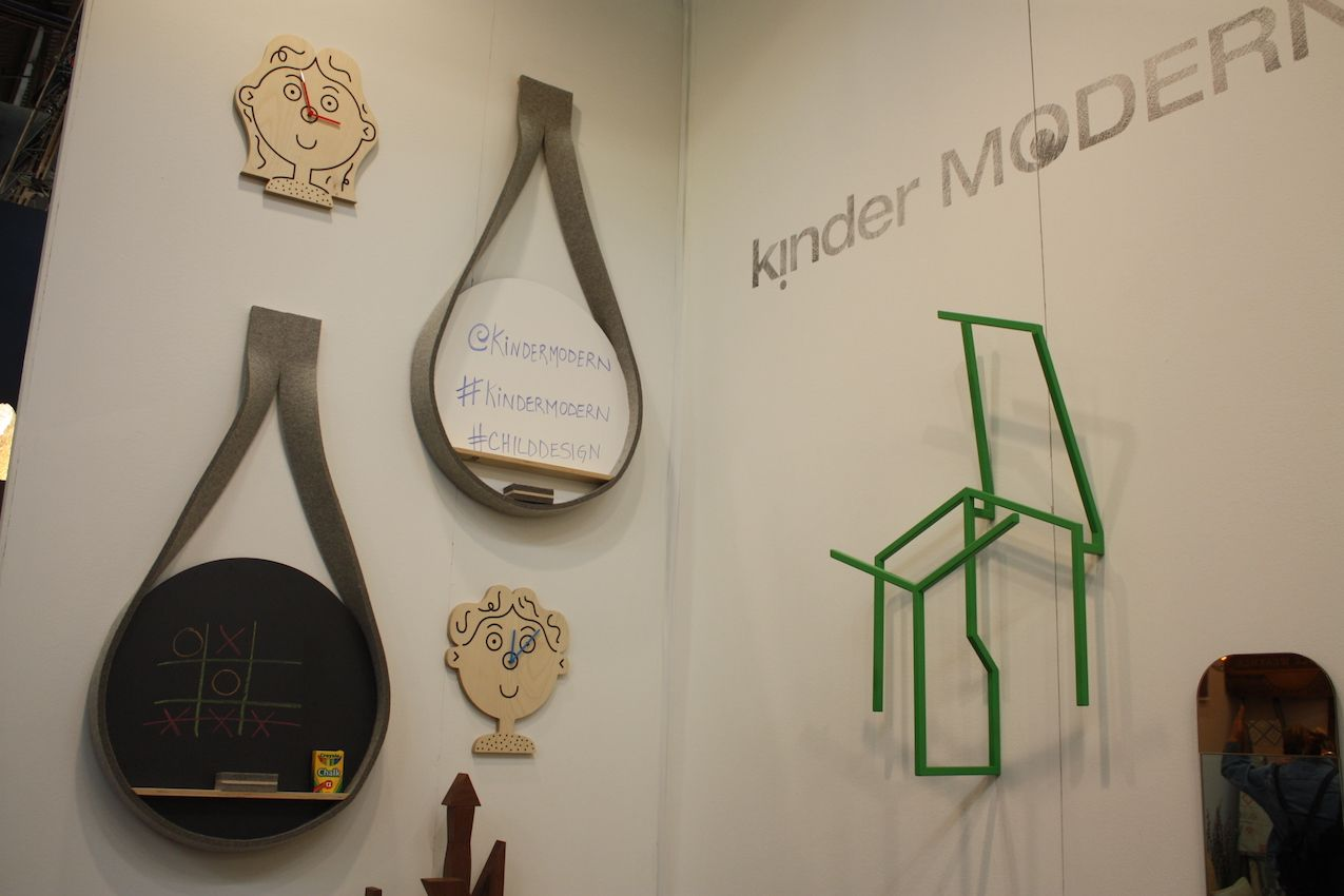 "A collection of wall decor and accessories include a Garman hanging chalk board and a white board, as well as clock ""faces"" and a unique chair sculpture by Erik Nystrum."