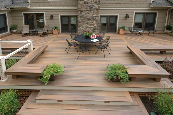 Instead of railings, you can line the deck with a raised platform that doubles as a bench