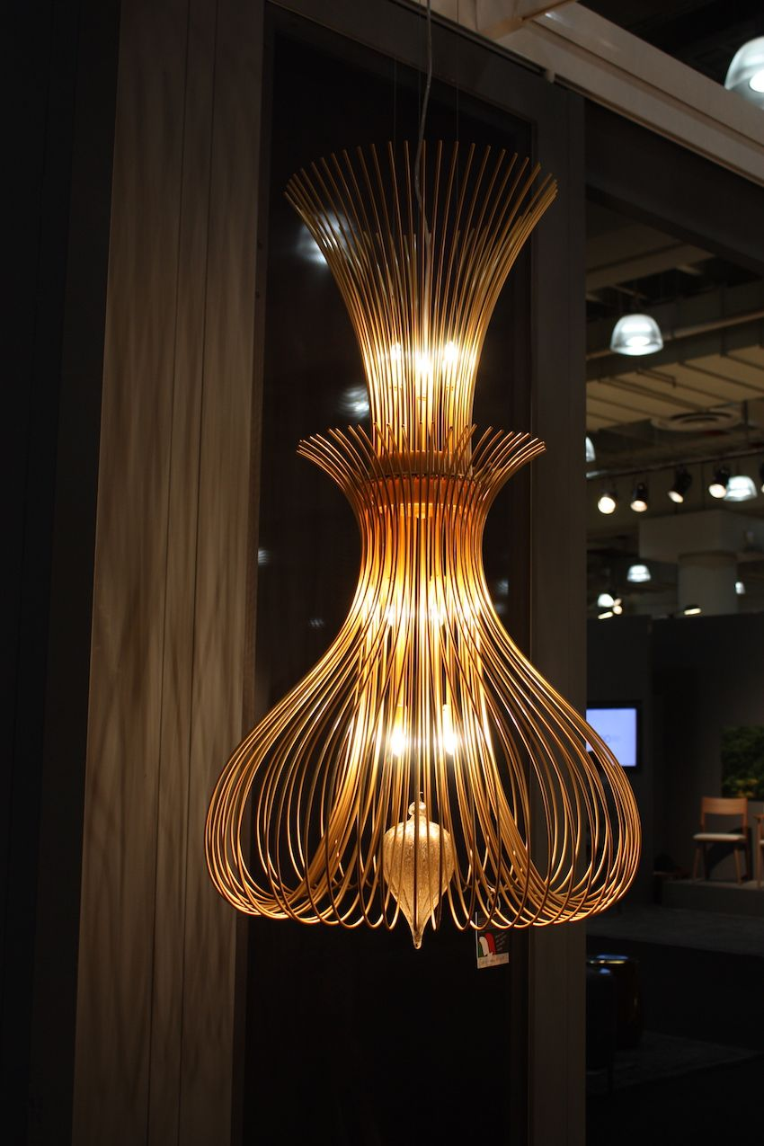 "This light and airy chandelier from Metal Lux is the Silhouette Ø 60 suspension light. The structure is made of metal wire with a Murano glass blown drop. The shape was ""inspired by the elegance of the delicate contours of the body of a woman, as a dress caressing the sinuous contours of an elegant lady."""