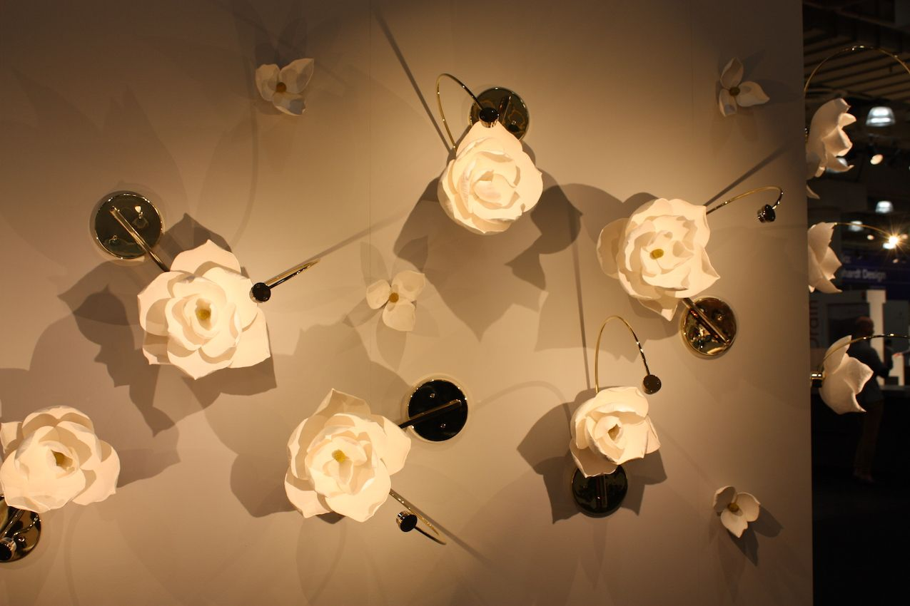 This wall is a literal flower garden with a grouping of the Lure sconces -- truly an artful way to light up a room!