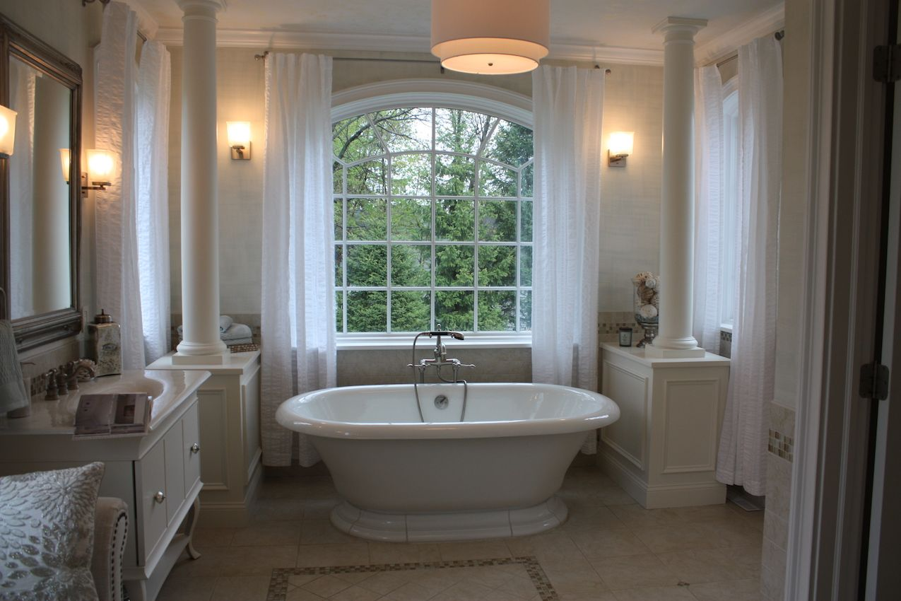 Wow...that's the only word that comes to mind when you see this bathroom. The free-standing bathtub in front of the stunning window is the focal point of this neutral space. Designer Stephanie Salway of Starlily Design Studio painted the walls in a seagrass-hued grasscloth weave pattern.