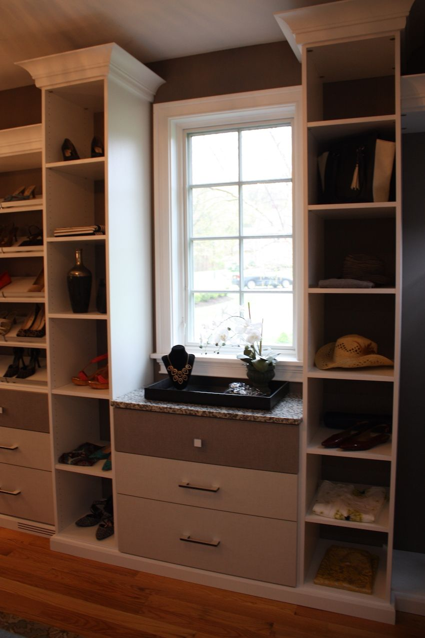 Plenty of open storage, shoe shelving and drawers for accessories and jewelry make the closet even more useful.
