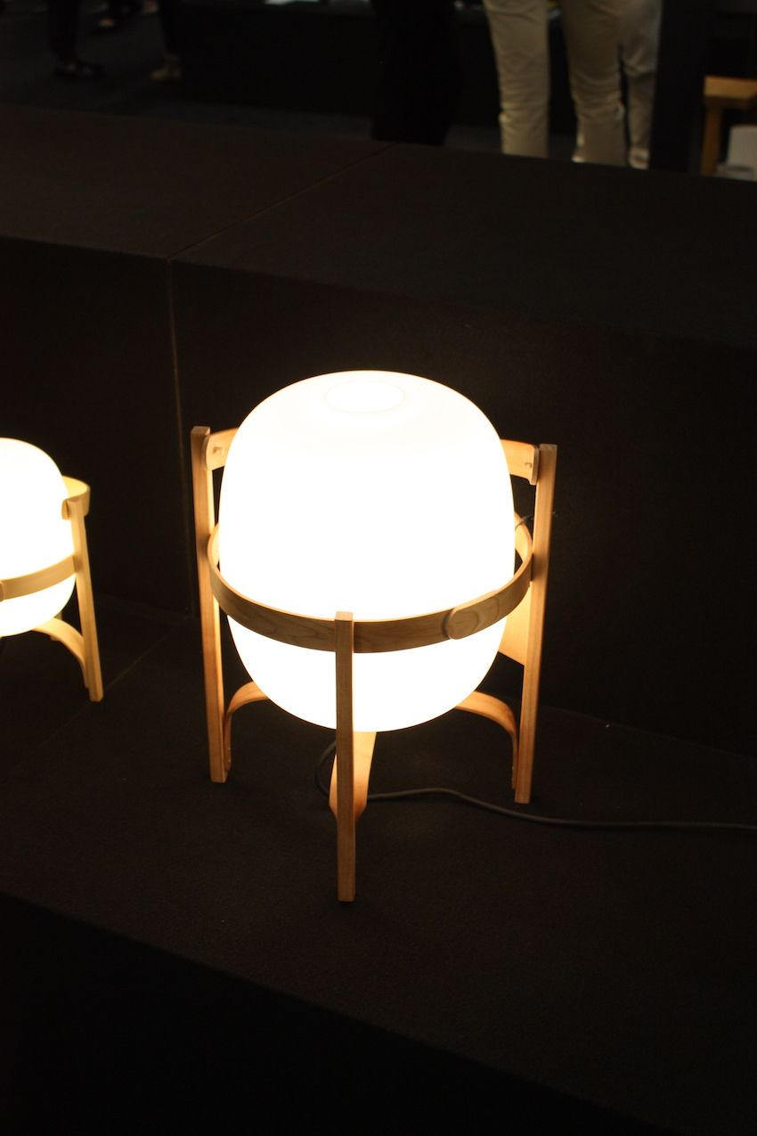 Designed by Catalan designer Miguel Mila has a cherry wood structure frame. It works as a table or floor lamp.