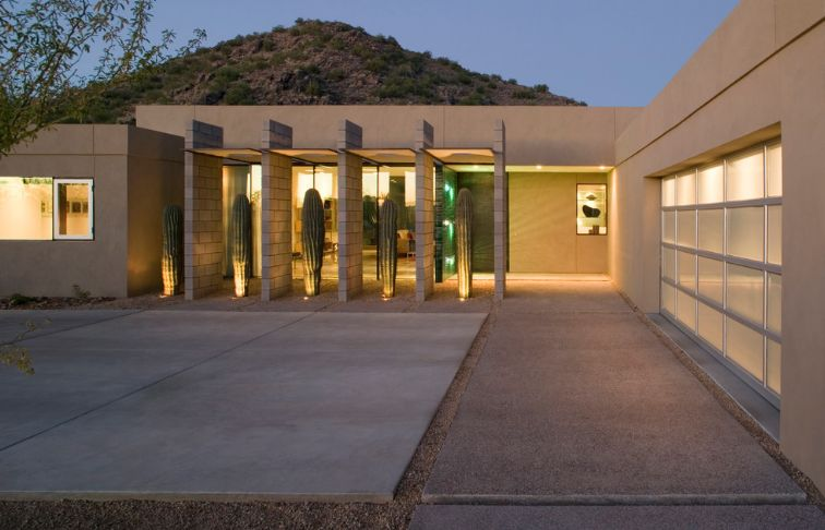 Modern entrance house with big Saguaro cactus