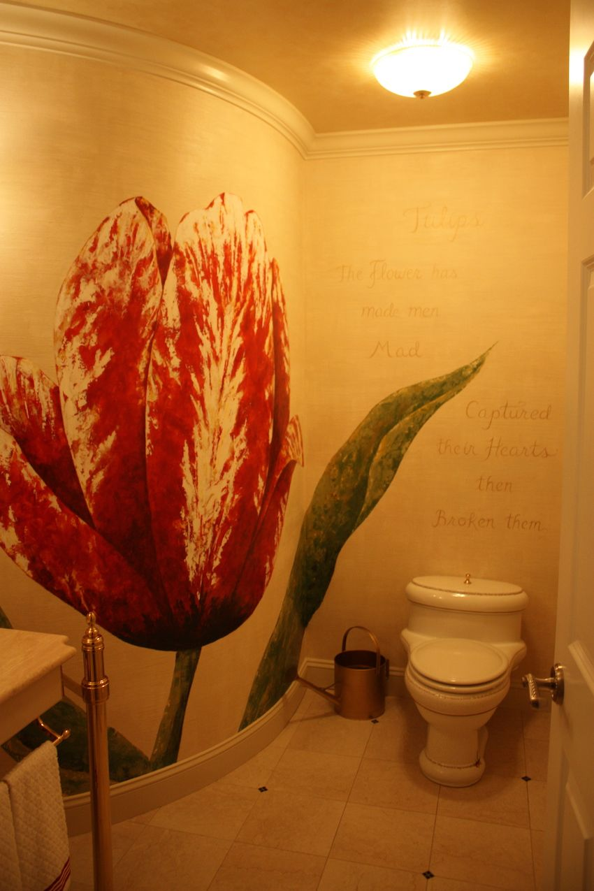 The formal powder room is a visual delight. Designer Rae Rau's decades of experience in stage design and painting show in this amazing tulip-themed powder room. Besides being a beautiful flower, the tulip was an important element in Albany's Dutch history.