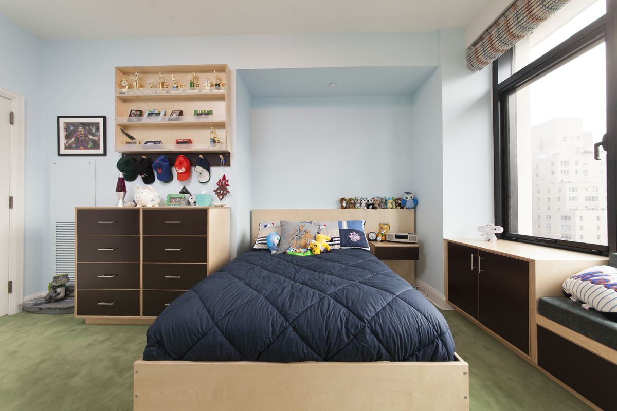 Their functional designs don't have to be bunk or loft beds, This room was designed for a single child to use through his teenage years, so it is not too juvenile. A natural finish highlights the full-size bed, dresser, desk and window bench. The bed has plentiful storage space thanks to the under-bed drawers.