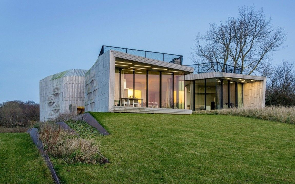 North Holland house with a clean lawn in backyard